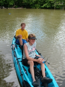 Julie and a friend's son Ty in a recreational race with the Hobie Oasis