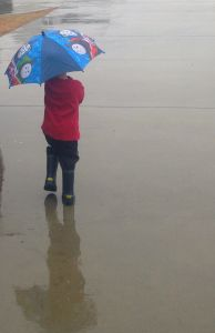 child with umbrella, boy, boy in the rain, blog about sorrow, overcoming sorrow, rainy day, hope beyone
