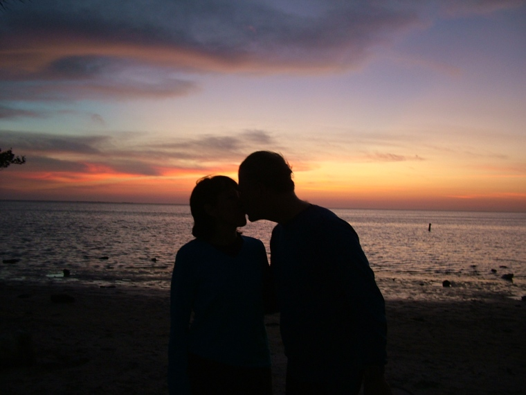 couple at sunset, couple by the shore, kissing, sunrise, couple at sunrise, Christian marriage, Christian couple
