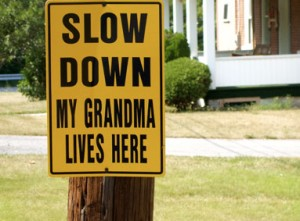 slow but sure, slowly but surely, senior crossing, traffic sign, grandma, grandmother, sign