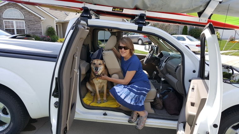 woman with dog, German shepherd, travelling, pet, Nissan Frontier, trip, jump seat