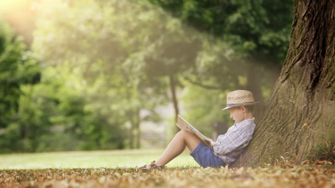 boy, under a tree, child, reading, book, green spaces, nature, benefits, viewing, attention