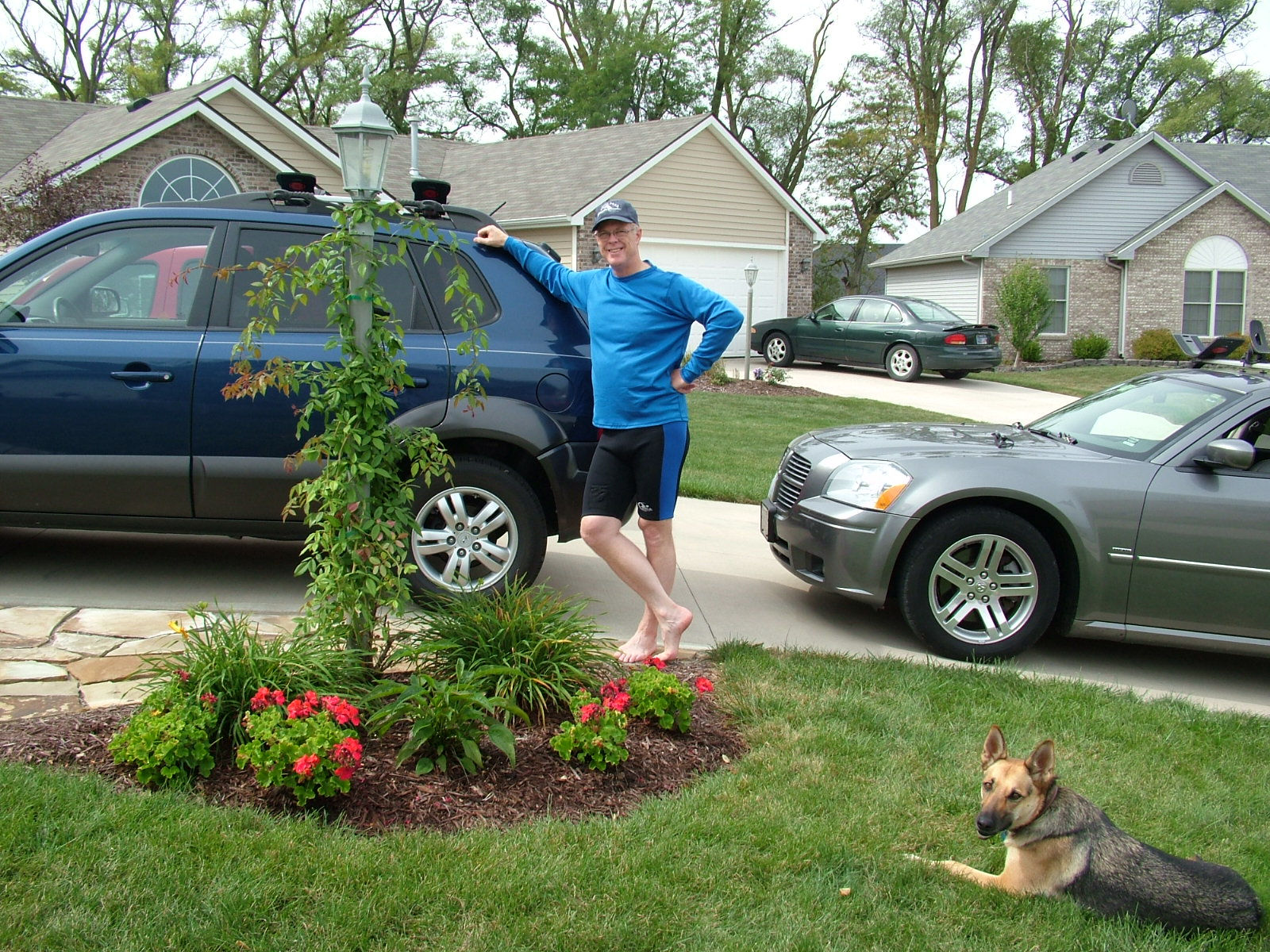 Hyundai, Tuscon, German shepherd, garden, light pole, garden bed, Dodge Magnum, paddling gear, front driveway, holding things lightly, Christian man